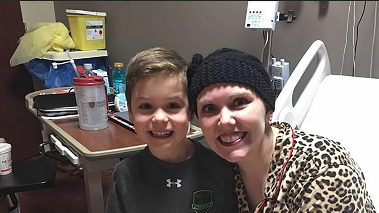 A young boy is baking cookies to raise money for his teacher who has cancer.
