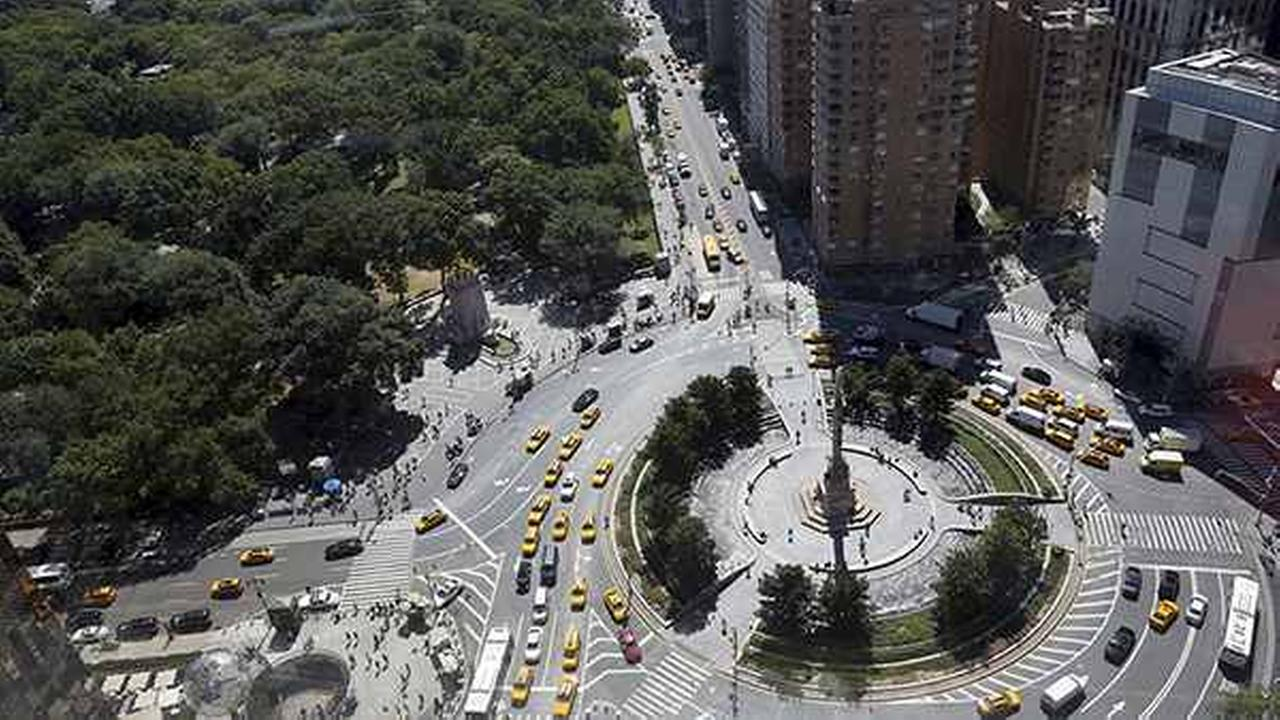 Traffic makes its way across Central Park South towards Columbus Circle in 2013 in New York.