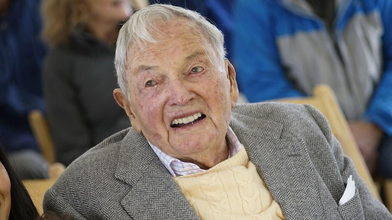 David Rockefeller smiles as he greets family and friends at a ceremony, Friday, May 22, 2015, in Mount Desert, Maine.