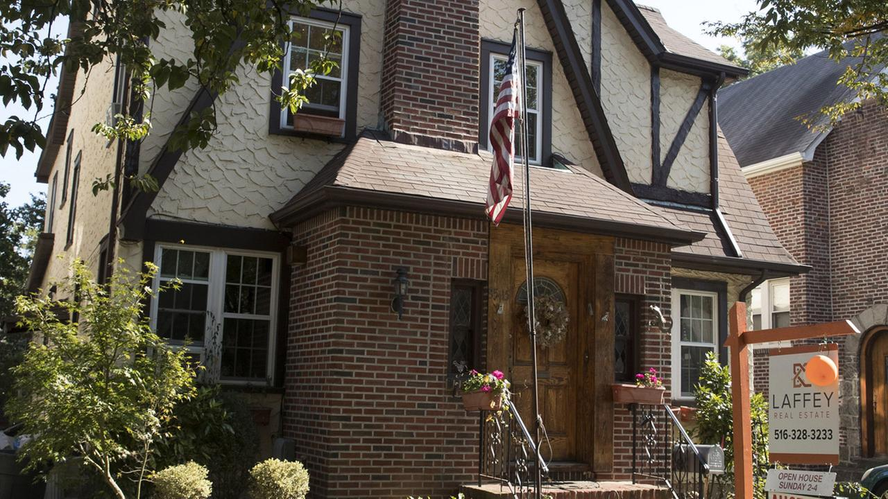 This 2016 photo shows the exterior of a house in the Jamaica Estates neighborhood of the Queens borough of New York, where Donald Trump spent his early childhood.