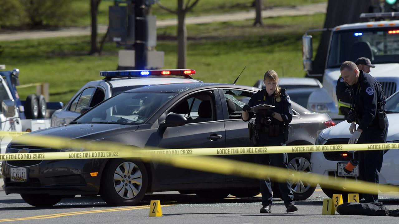 Police officers investigate the scene of an accident on Capitol Hill in Washington, Wednesday, March 29, 2017.