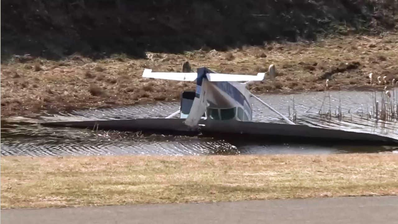Small plane with 4 on board flips over on landing at airport in Dutchess County