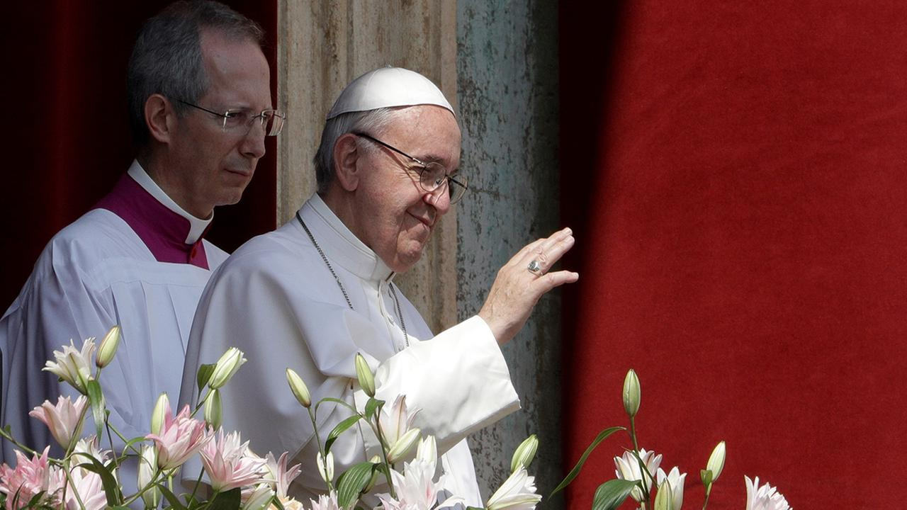 Pope Francis delivers his Urbi et Orbi (to the city and to the world) from the main balcony of St. Peters Basilica  (AP Photo/Andrew Medichini)