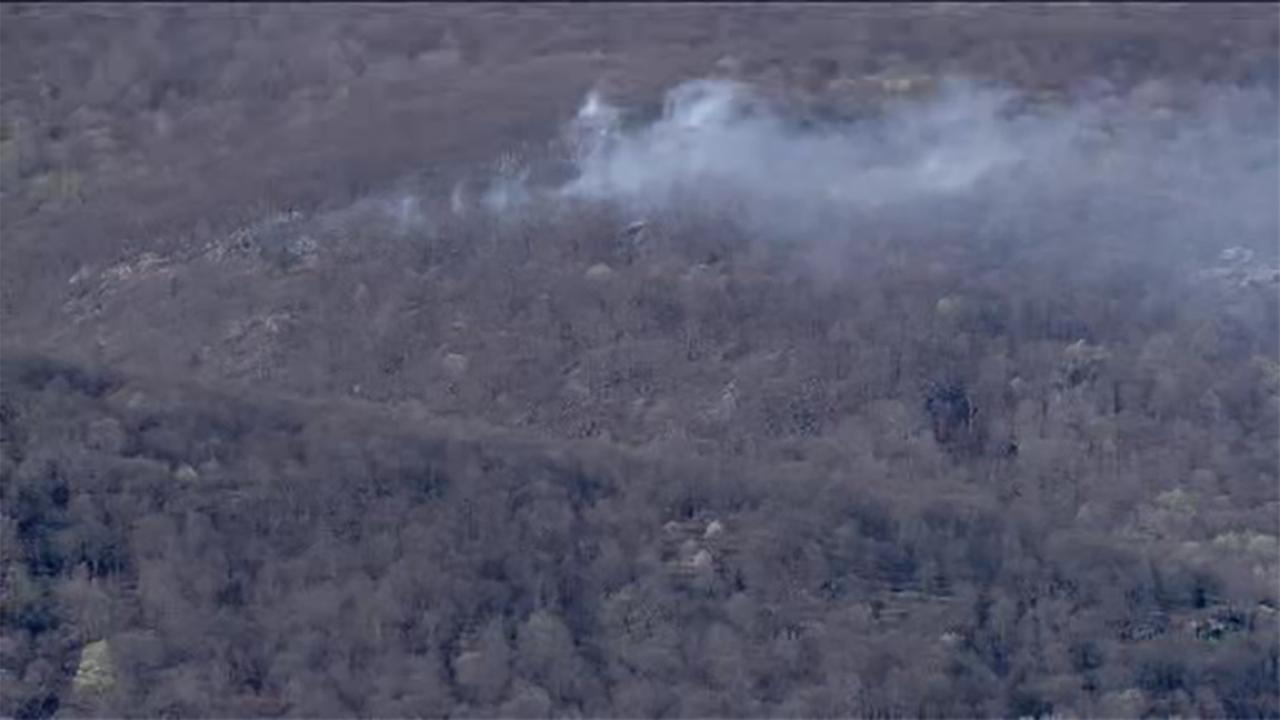 Hikers escape from wildfire at Ramapo Reservation in Mahwah, New Jersey