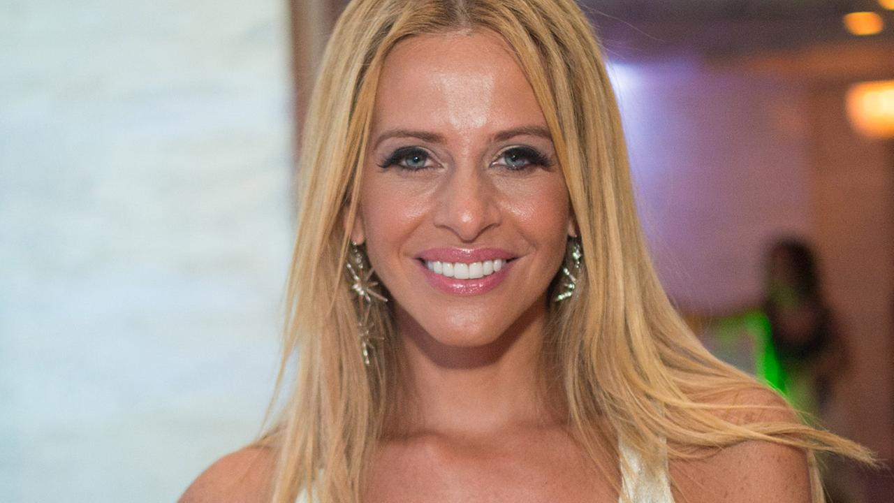 Dina Manzo attends The Real Housewives of New Jersey White Party at the Woodbury Country Club on Monday, July 21, 2014 in New York.