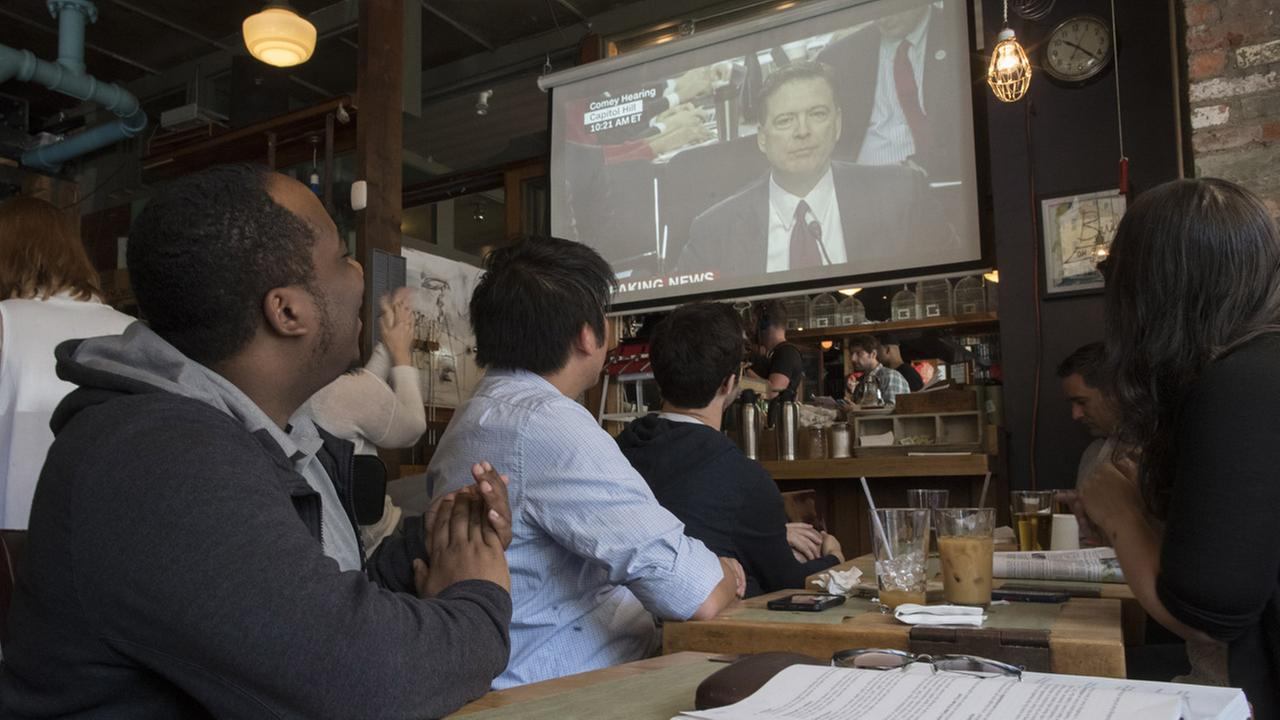 James Comey watch party at bar in Brooklyn