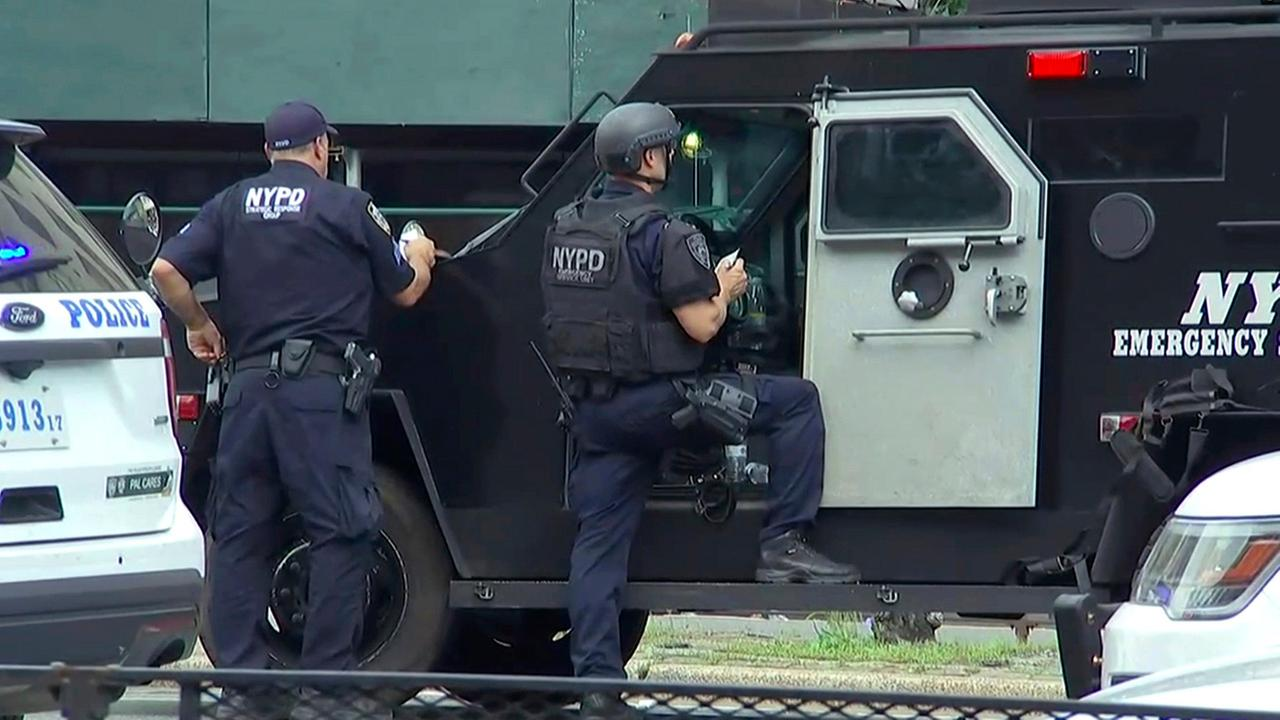 NYPD ESU officers stand by their armored vehicle outside Bronx Lebanon Hospital in New York, after a gunman opened fire there on Friday, June 3