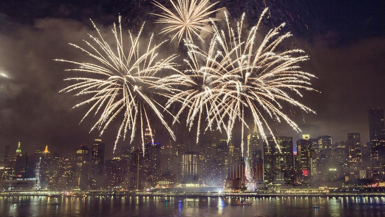 with the new york city skyline in the background fireworks explode during an independence day show