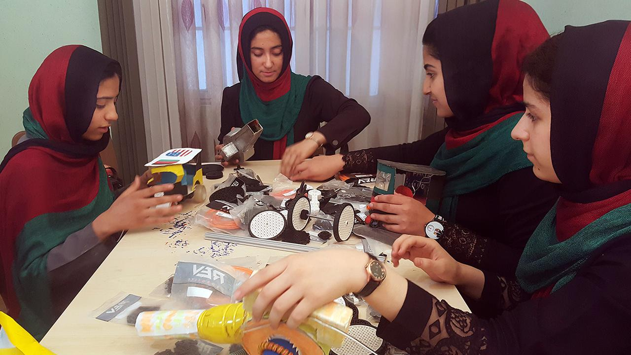 In this Thursday, July 6, 2017 photo, teenagers from the Afghanistan Robotic House, a private training institute, practice at the Better Idea Organization center, in Afghanistan