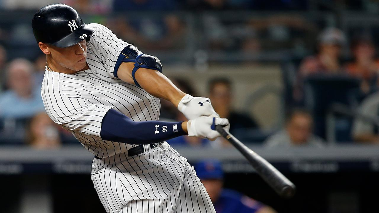 New York Yankees Aaron Judge hits a home run against the New York Mets during the sixth inning Monday night.  (AP Photo/Rich Schultz)