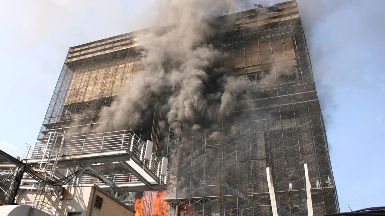 A fire that claimed the lives of two firefighters burns in the former Deutsche Bank office building in New York on in this Aug. 18, 2007 file photo.