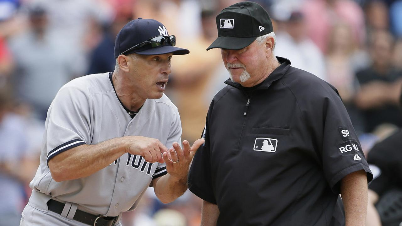 Yankees manager Joe Girardi, left, argues with umpire crew chief Dana DeMuth after being ejected by home plate umpire Carlos Torres during the sixth inning of a baseball game.