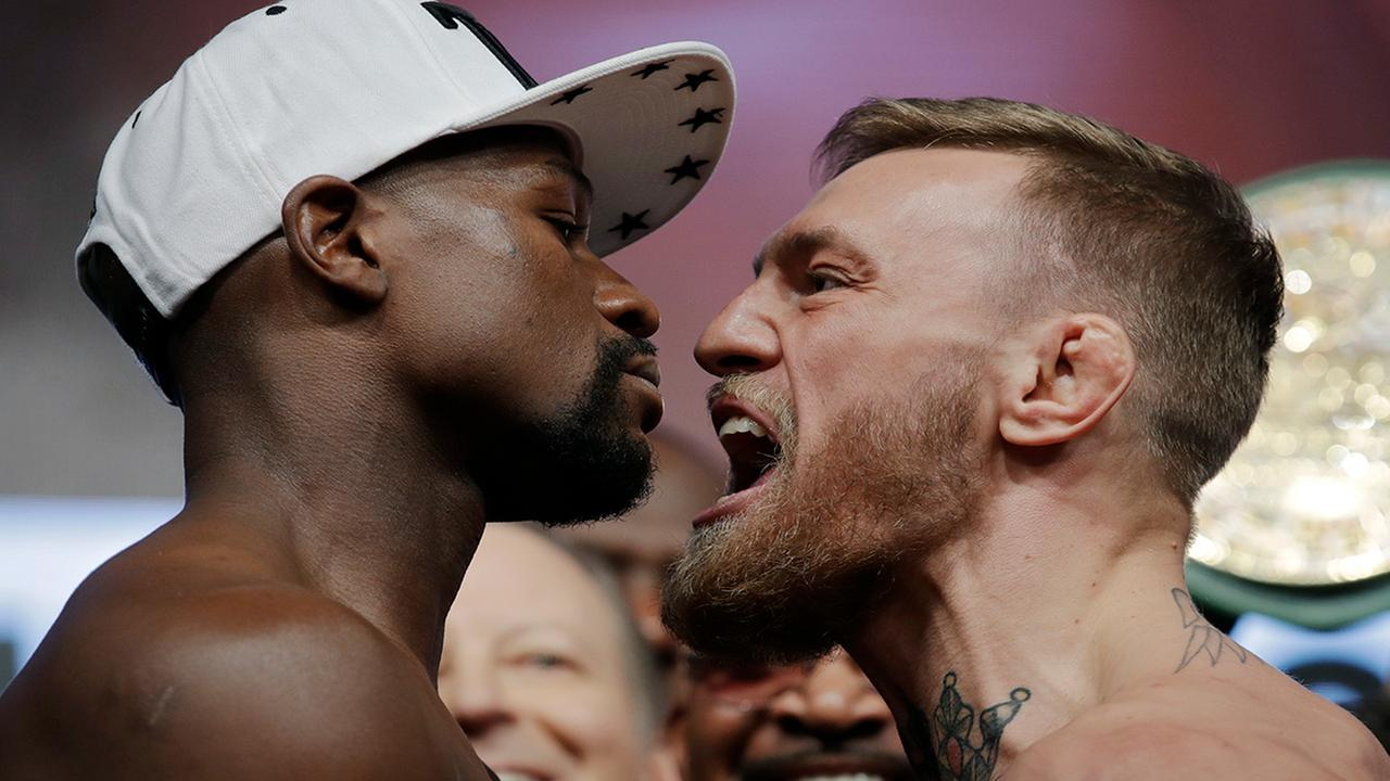 Floyd Mayweather Jr., left, and Conor McGregor face off during a weigh-in Friday, Aug. 25, 2017, in Las Vegas.  (AP Photo/John Locher)