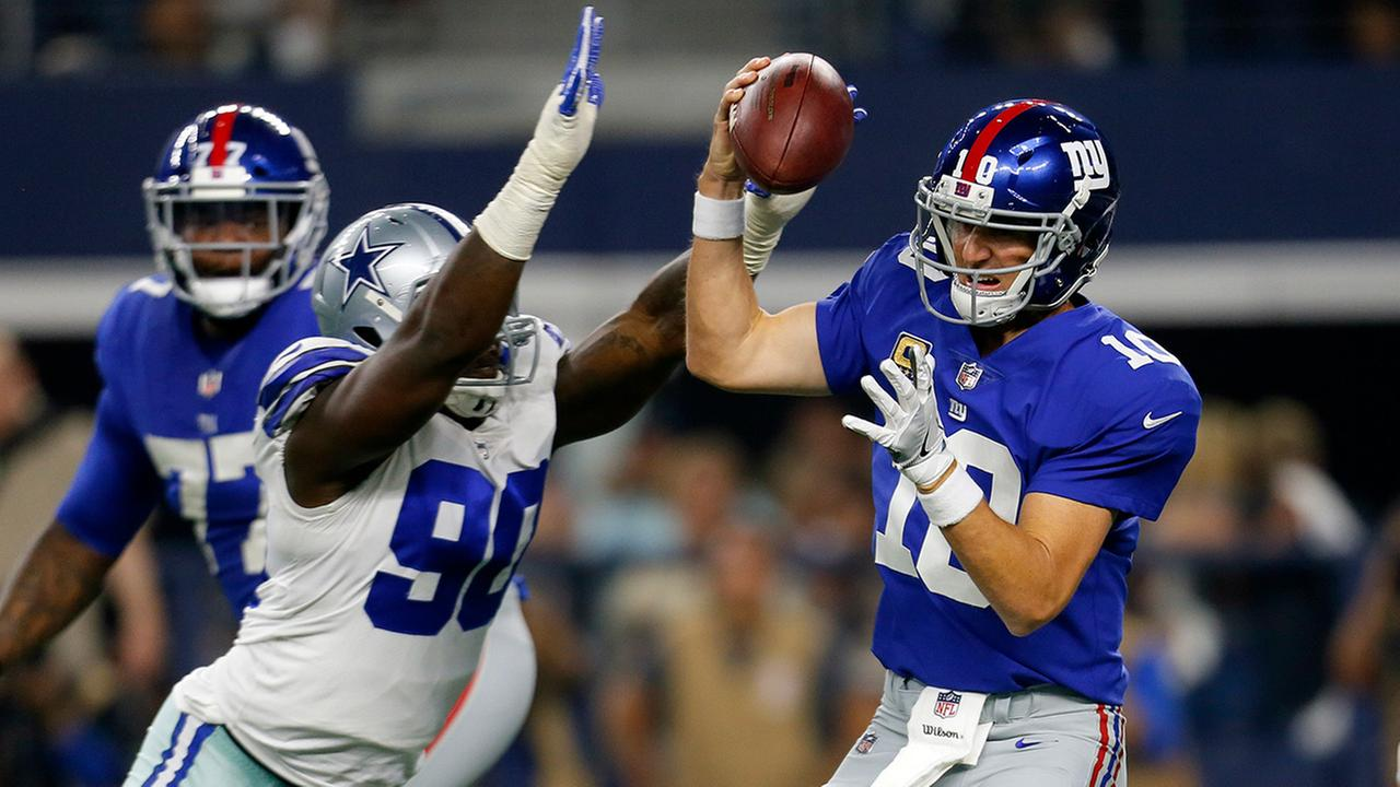Dallas Cowboys defensive end DeMarcus Lawrence sacks Giants quarterback Eli Manning in the first half of an NFL football game, Sunday, Sept. 10, 2017, in Arlington, Texas