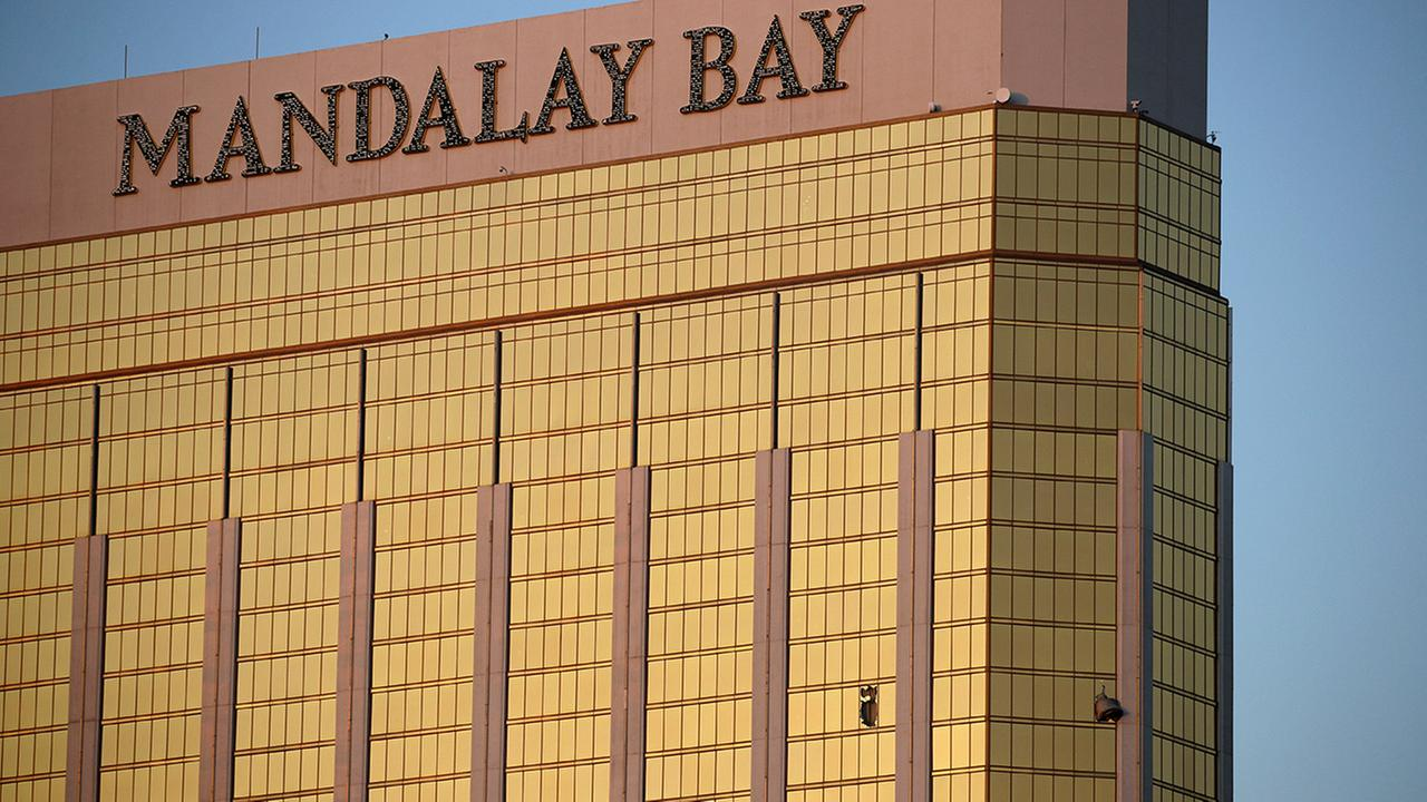 Drapes billow out of broken windows at the Mandalay Bay resort and casino Monday, Oct. 2, 2017.