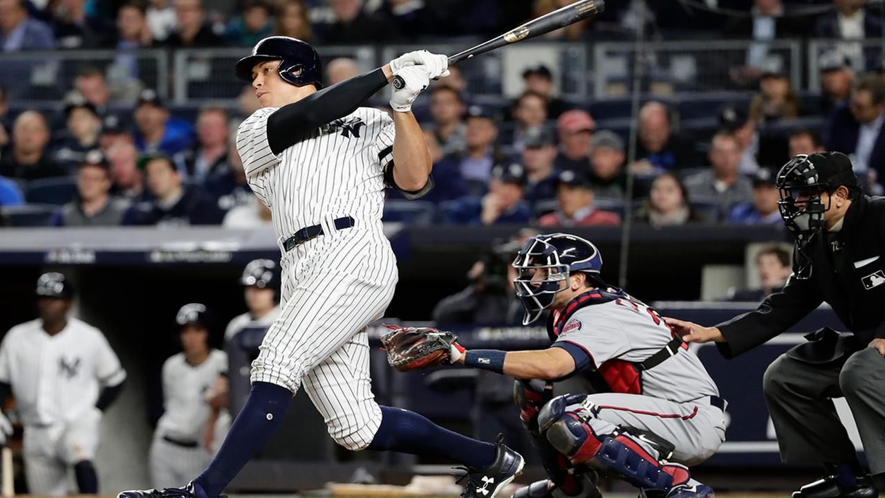 New York Yankees Aaron Judge follows through on a two-run home run during the fourth inning of the American League wild-card baseball game against the Minnesota Twins