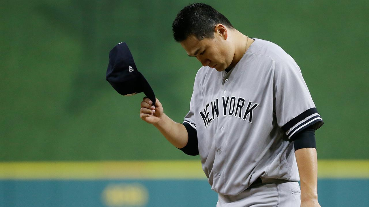 Yankees starting pitcher Masahiro Tanaka walks back to the dugout after the Astros scored two runs during the fourth inning of Game 1 of the ALCS Friday, Oct. 13, 2017, in Houston.