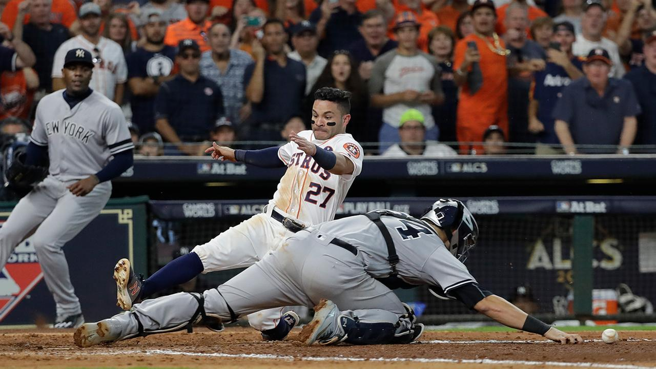 Houston Astros Jose Altuve scores the game-winning run past New York Yankees catcher Gary Sanchez during the ninth inning of Game 2  (AP Photo/David J. Phillip)