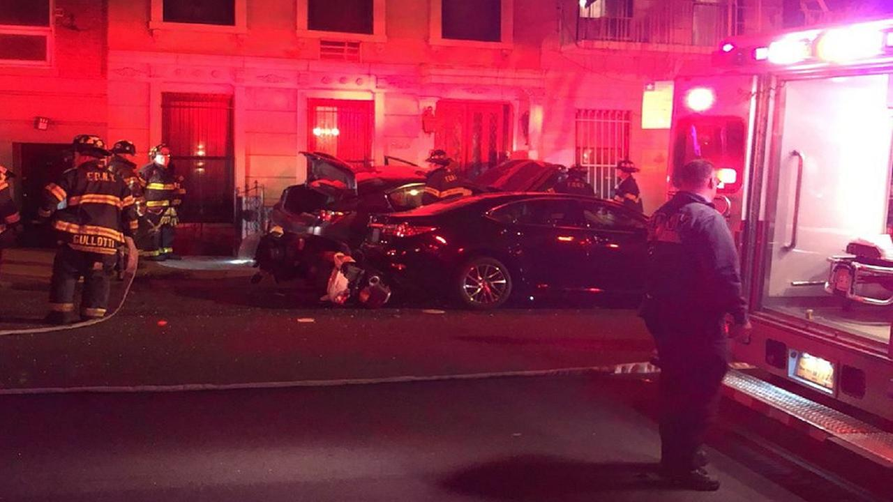 Car jumps curb, strikes Upper East Side building