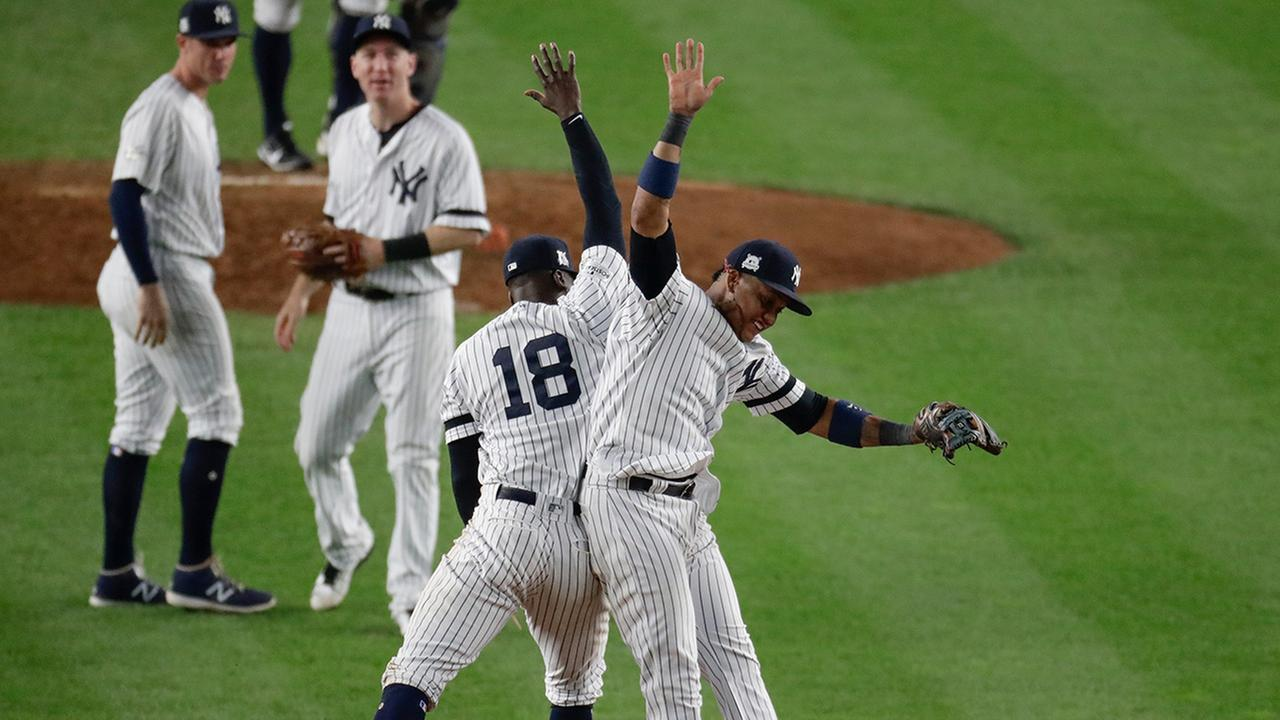 The Yankees Didi Gregorius and Starlin Castro celebrate after Game 5 of baseballs ALCS against the Atros Wednesday, Oct. 18, 2017, in New York.