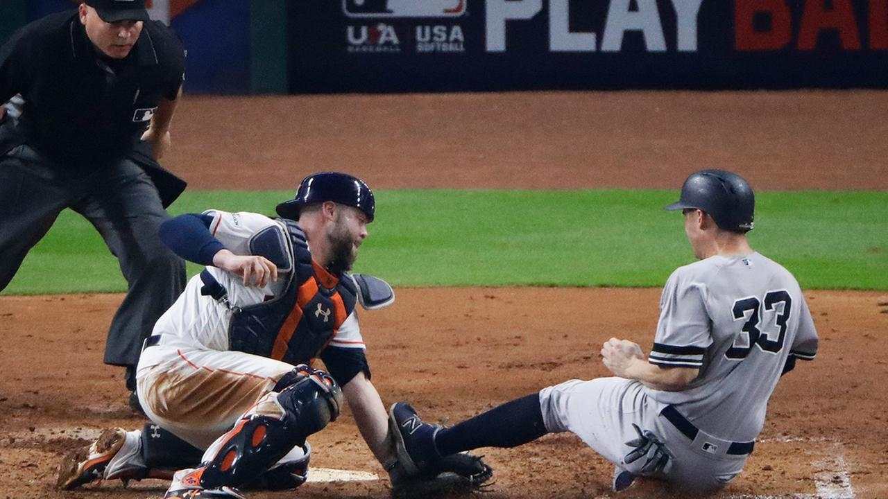 Houston Astros catcher Brian McCann tags out New York Yankees Greg Bird at home during the fifth inning of Game 7 of American League Championship Series.