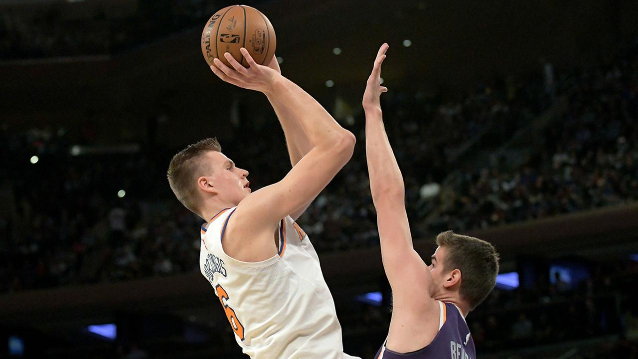 New York Knicks forward Kristaps Porzingis shoots over Phoenix Suns forward Dragan Bender during the first quarter of an NBA basketball game Friday, Nov. 3 in New York