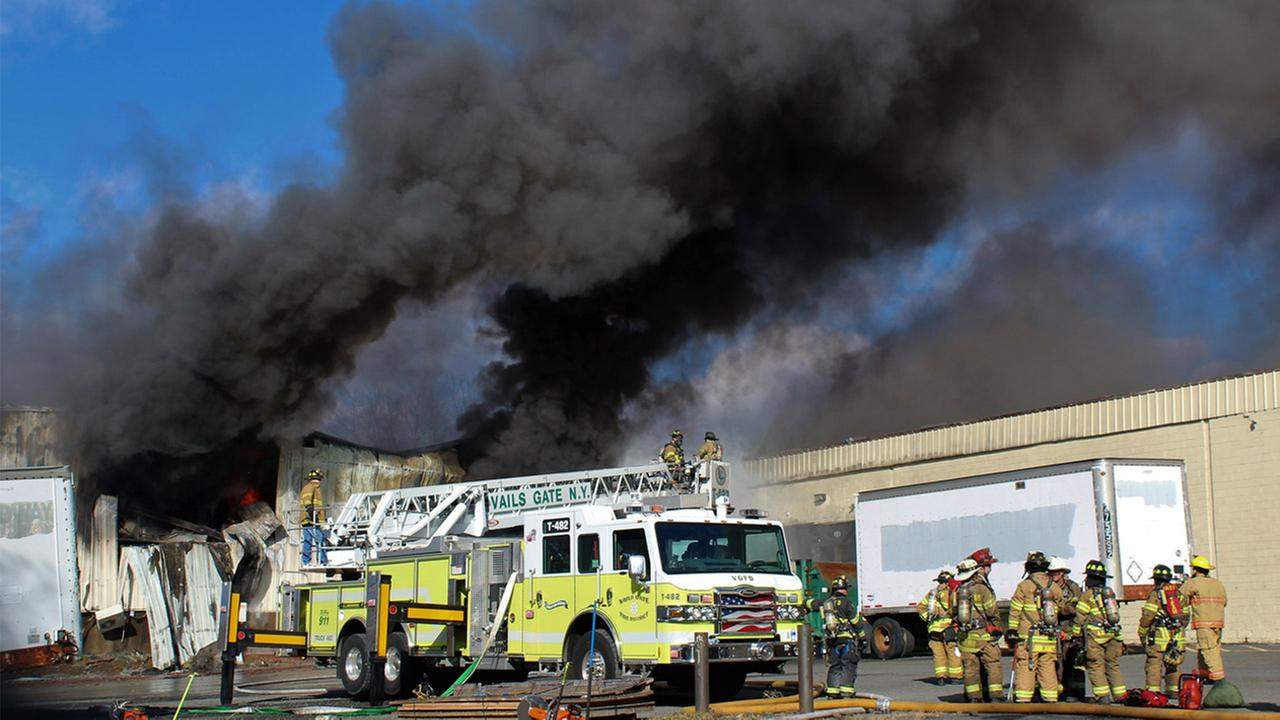 Firefighters work at the scene of of a fire Monday, Nov. 20, 2017, at the Verla International cosmetics factory on Temple Hill Road in New Windsor, N.Y.