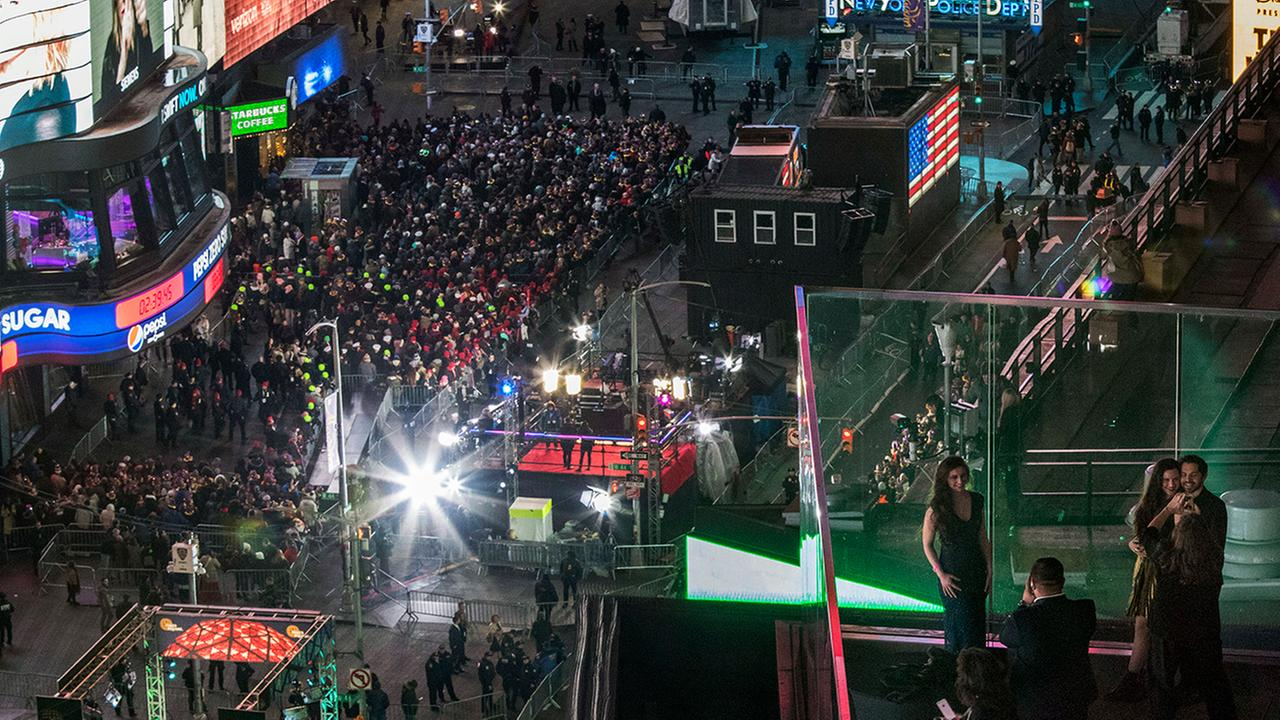 Revelers take part in the New Years Eve celebration in New Yorks Times Square as seen from the Marriott Marquis, Saturday, Dec. 31, 2016. (AP Photo/Mary Altaffer)