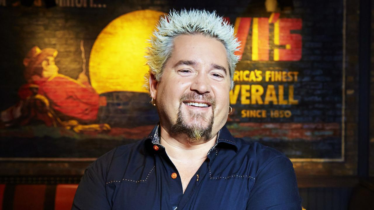 Guy Fieri poses for a portrait, on Monday, Dec. 9, 2013 in New York.