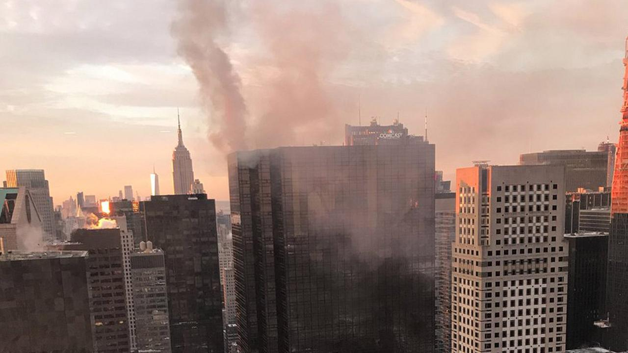 Smoke rises from Trump Tower in New York, Monday, Jan. 8, 2018. The department said the fire started Monday in the heating and air conditioning system of the building.