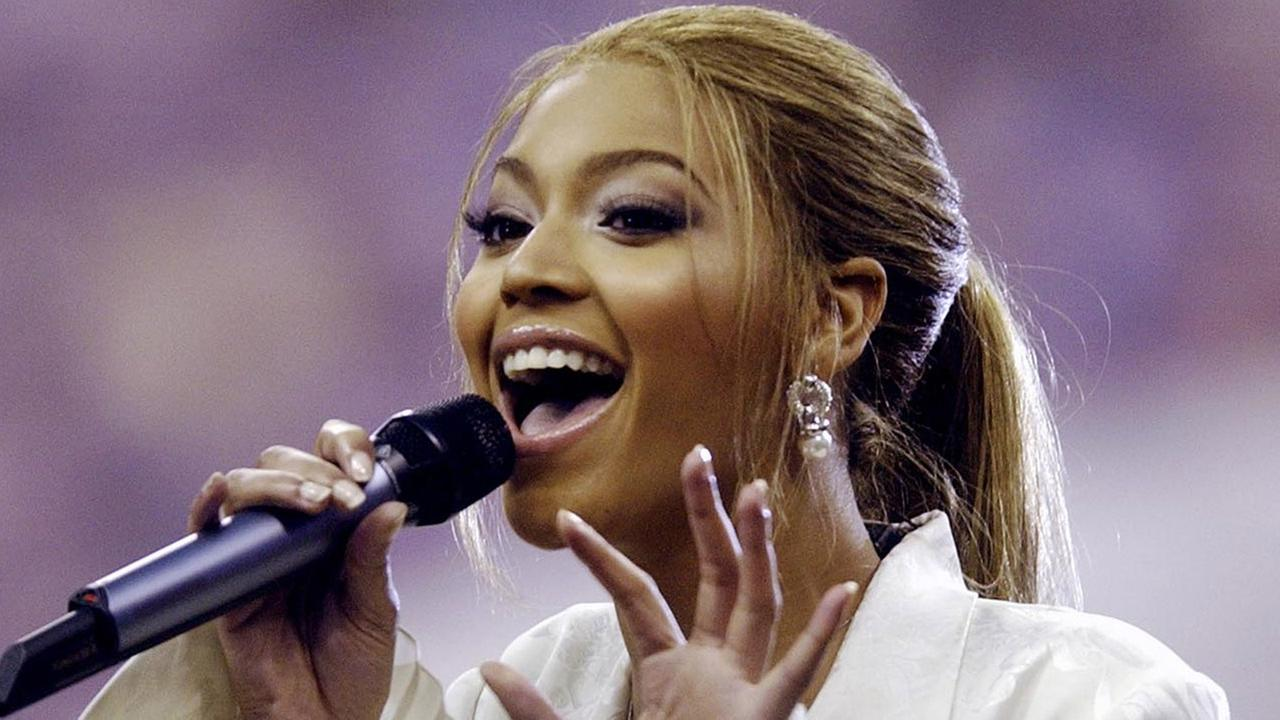 Entertainer Beyonce Knowles sings the national anthem before Super Bowl XXXVIII on Sunday, Feb. 1, 2004, at Reliant Stadium in Houston.