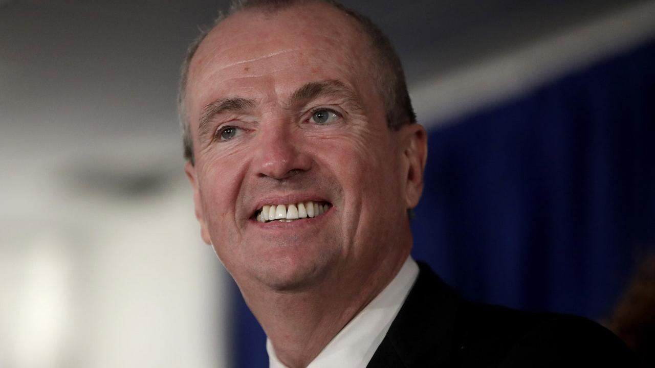 New Jersey Gov. Phil Murphy speaks before signing the first executive order of his administration in Trenton, N.J., Tuesday, Jan. 16, 2018.