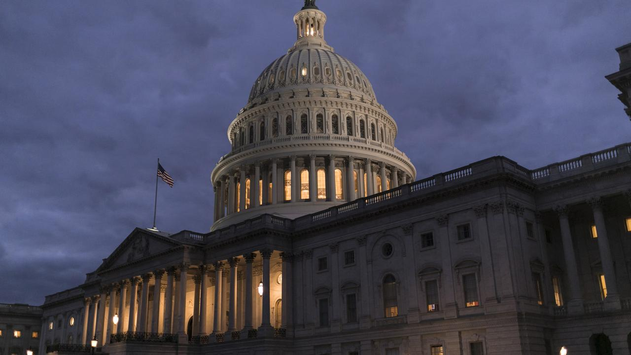 Lights illuminate the U.S. Capitol on second day of the federal shutdown as lawmakers negotiate behind closed doors in Washington, Sunday, Jan. 21, 2018.