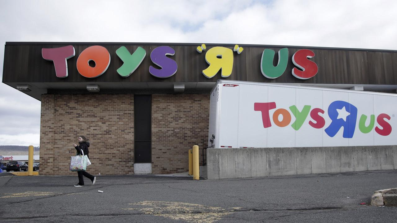 A woman walks near the loading dock of a Toys R Us store, Wednesday, Jan. 24, 2018, in Wayne, N.J.