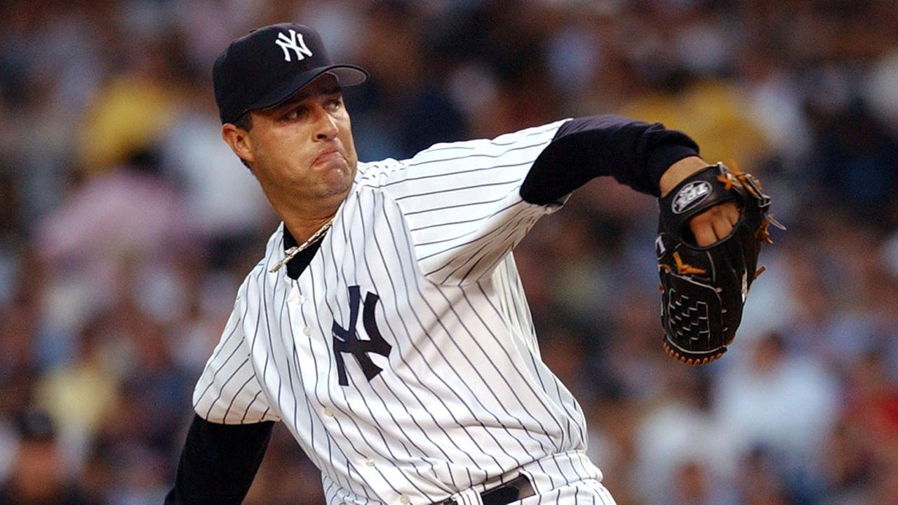 New York Yankees pitcher Esteban Loaiza delivers a pitch in the first inning to the Oakland Athletics , Aug. 4, 2004 at Yankee Stadium in New York