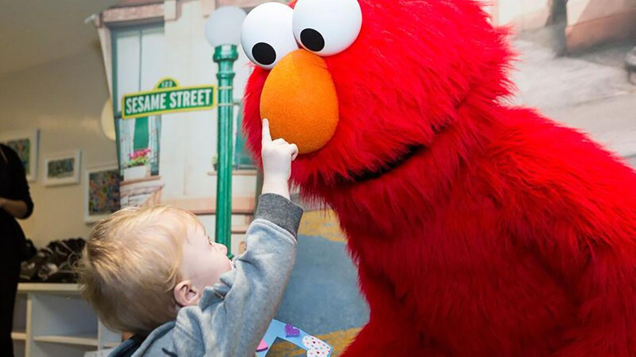 Elmo and friends visit sick children in New York City