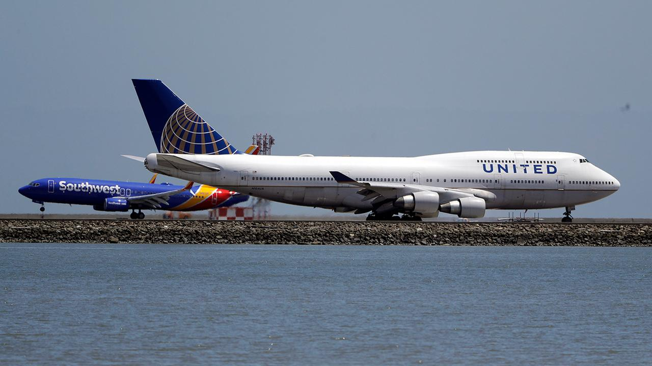FILE - This Tuesday, July 11, 2017, file photo, shows a United Airlines jet on a runway.  (AP Photo/Marcio Jose Sanchez, File)