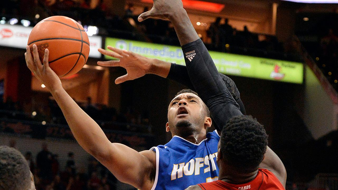 Hofstras Zeke Upshaw attempts a shot over the defense of Louisvilles Montrezl Harrell during the first half of an NCAA college basketball game on Nov. 12, 2013, in Louisville.