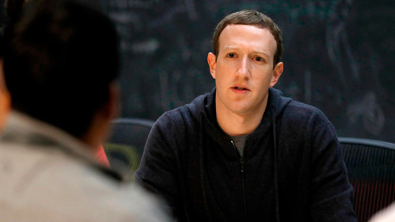 In this Nov. 9, 2017, file photo, Facebook CEO Mark Zuckerberg meets with entrepreneurs and innovators during a round-table discussion in St. Louis. (AP Photo/Jeff Roberson, File)