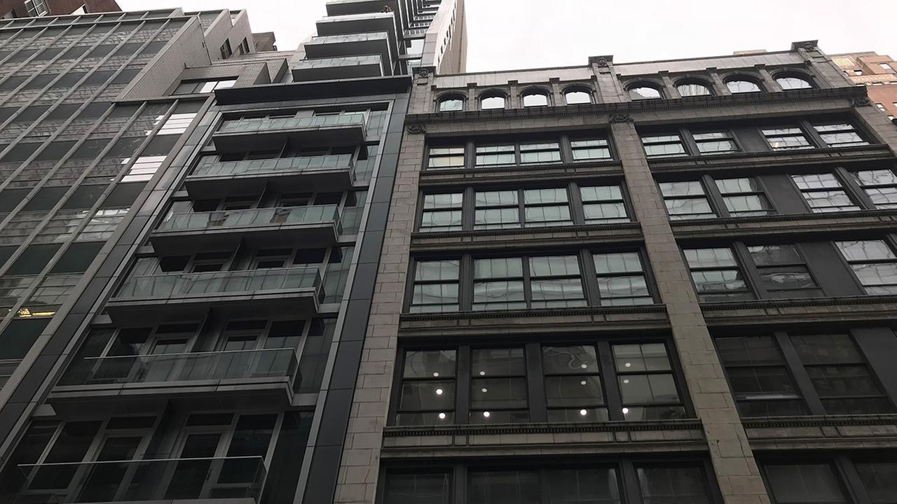 Playboy model jumps off building with 7-year-old boy