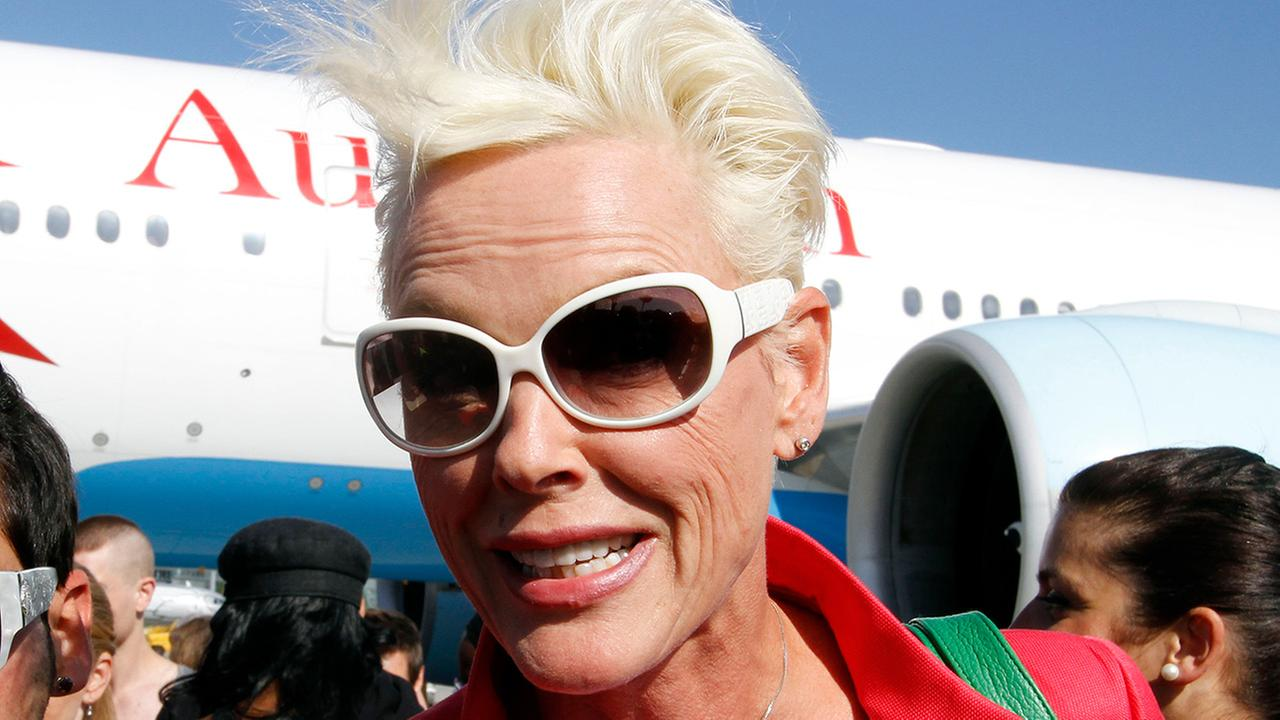 Brigitte Nielsen arrives at the Vienna International Airport near Schwechat, Austria on Friday, May 18, 2012 as a guest of the largest annual AIDS charity gala in Europe