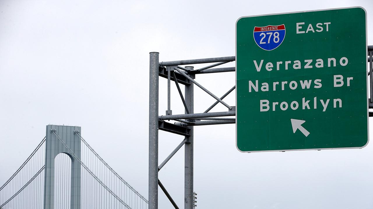 A road sign indicating an entrance to the Verrazano-Narrows Bridge is seen in New York, Wednesday, June 8, 2016.  (AP Photo/Seth Wenig)