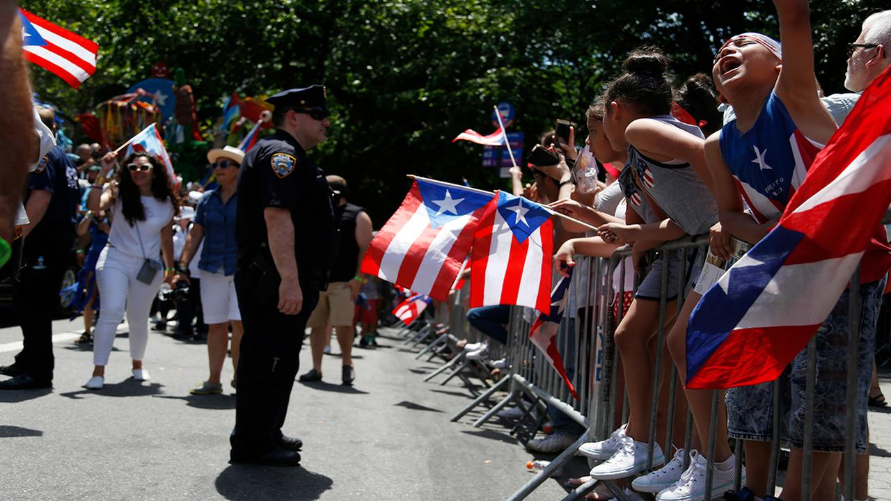 People cheers during the Puerto Rican Day Parade in New York, Sunday, June 11, 2017. (AP Photo/Seth Wenig)