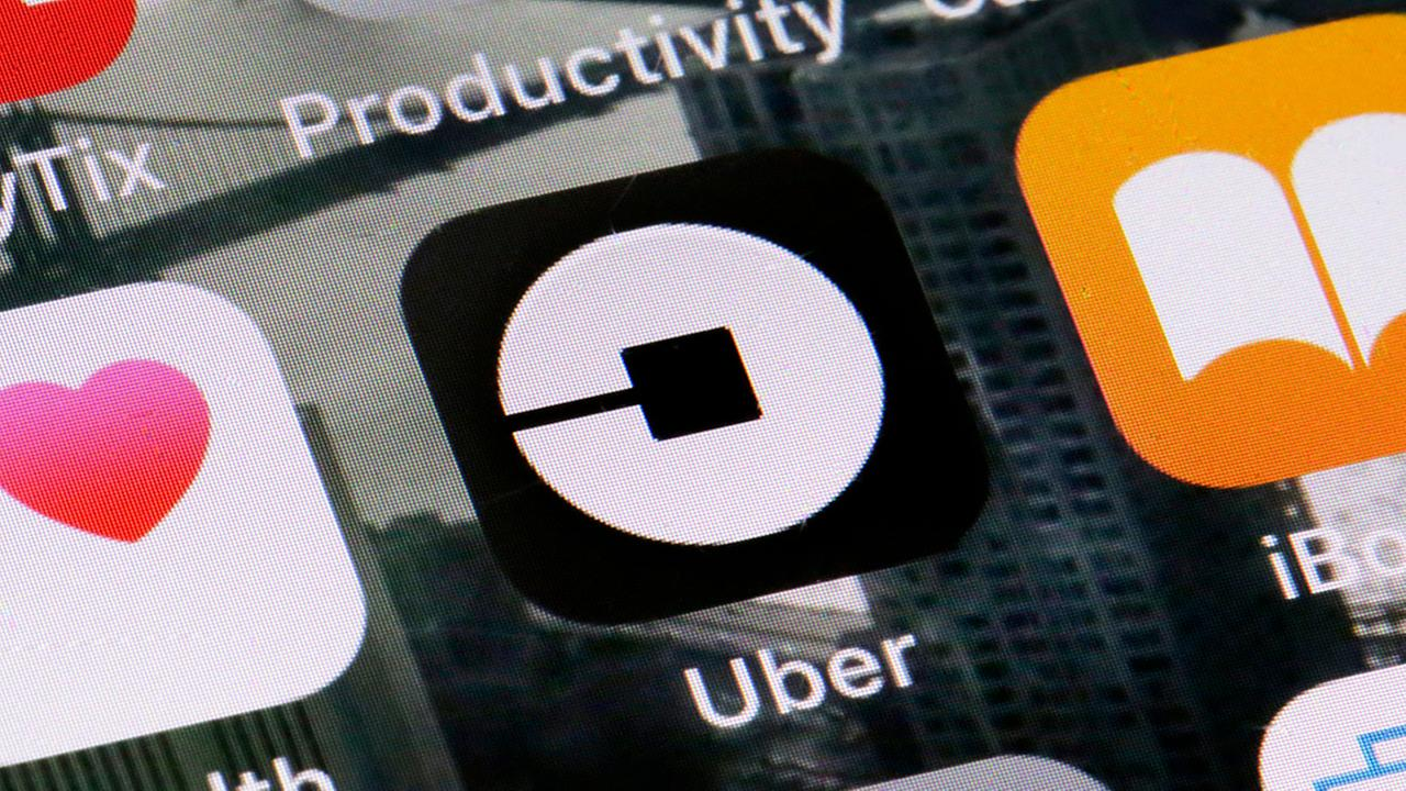 Uber CEO backs surcharge to aid struggling New York City taxi owners