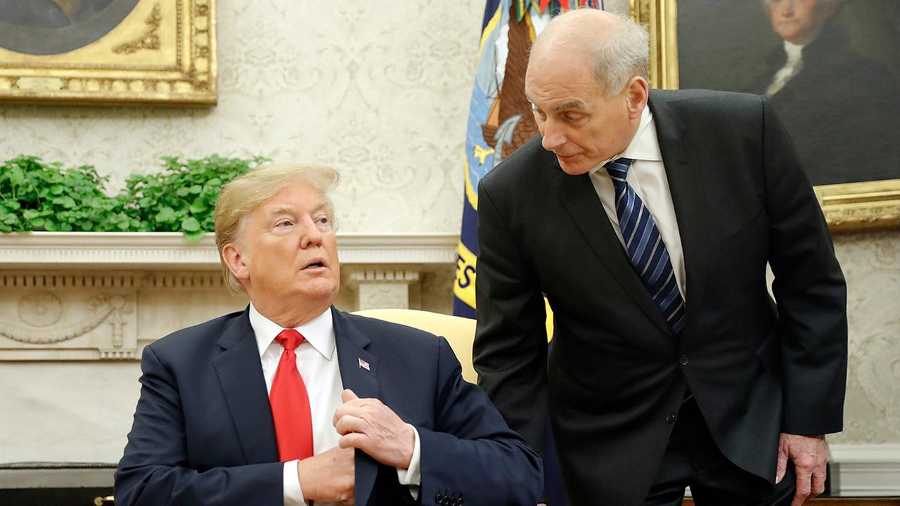 White House Chief of Staff John Kelly, right, leans in to talk with President Trump in the Oval Office in Washington, Wednesday, June 27, 2018. (AP Photo/Pablo Martinez Monsivais)