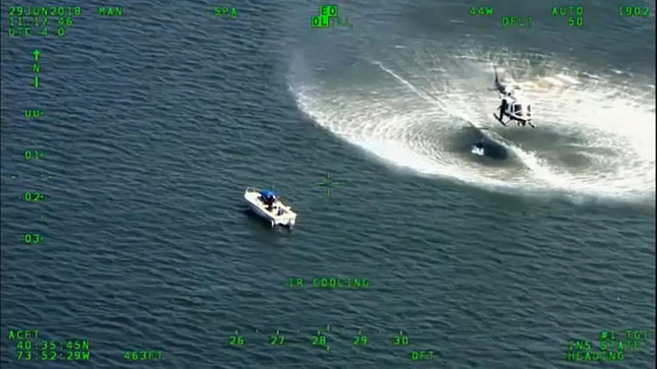 Police say a 30-foot boat in Jamaica Bay struck a small raft with two men inside.