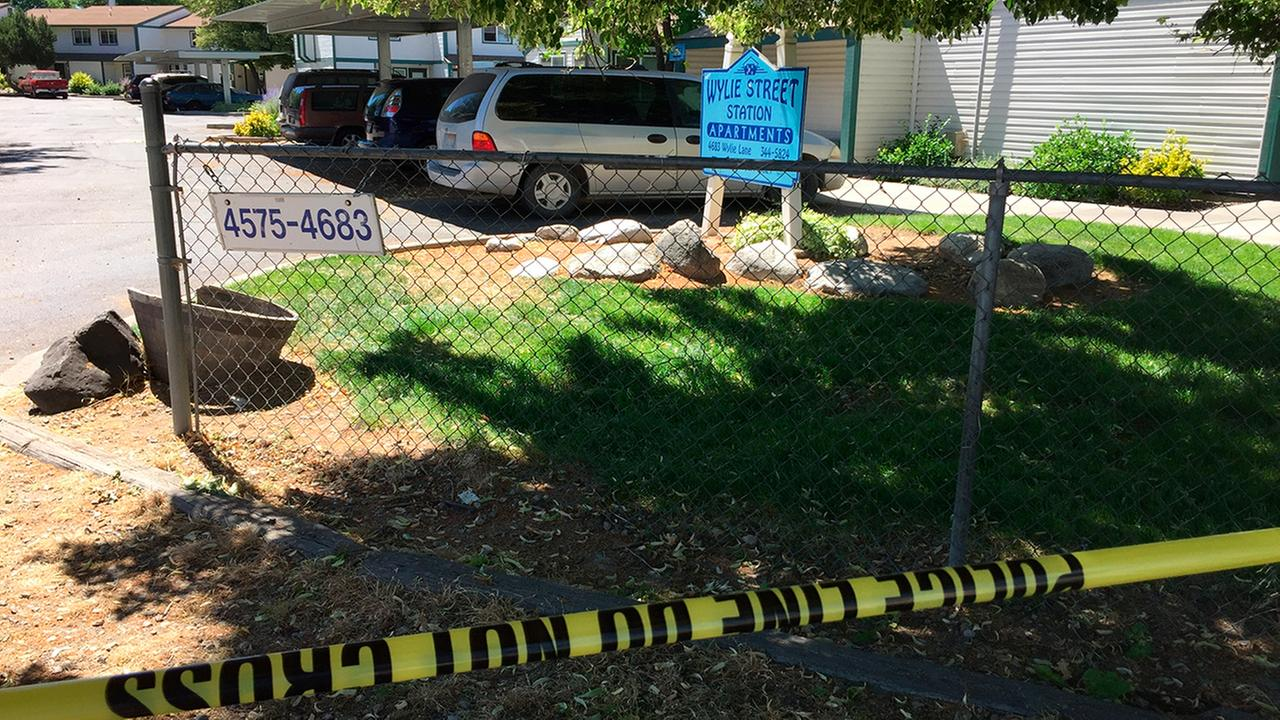 Police tape blocks off an area at a Boise, Idaho, apartment complex, Sunday, July 1, 2018, where nine people were stabbed (AP Photo/Rebecca Boone)