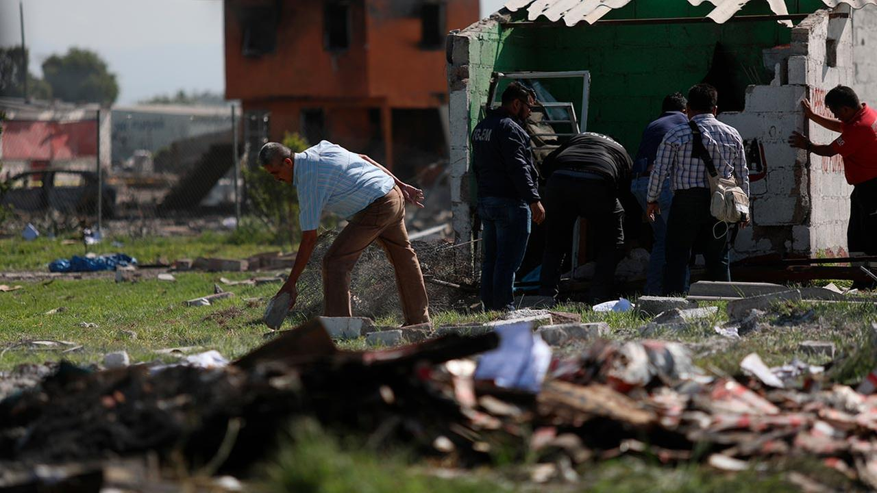 Locals search the area where several fireworks workshops blew up in Tultepec, Mexico, Thursday, July 5, 2018.  (AP Photo/Emilio Espejel)
