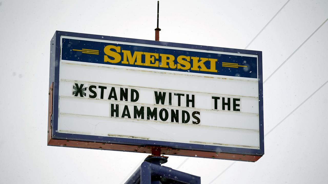 In this Jan. 5, 2016, file photo, a sign shows support for the Dwight and Steven Hammond in Burns, Ore.
