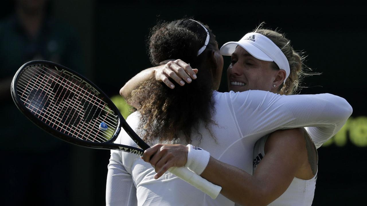 Angelique Kerber of Germany, right, meets Serena Williams of the United States at the net after defeating her in their womens singles final match. (AP Photo/Ben Curtis)